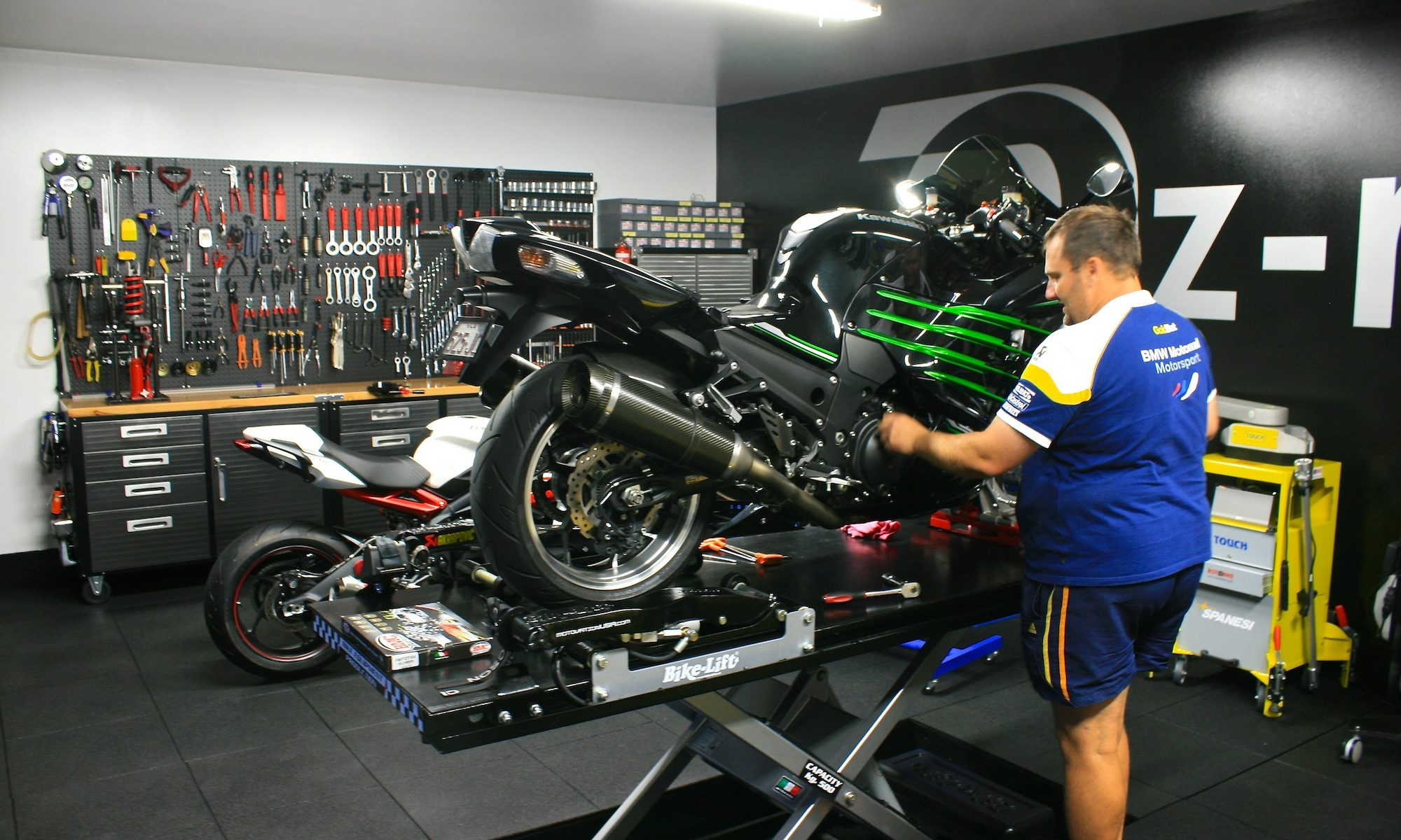 Ozzy Graf servicing a motorcycle in the Oz-racing workshop
