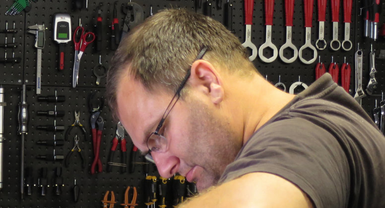 close-up headshot of master certified technician Ozzy Graf in his workshop