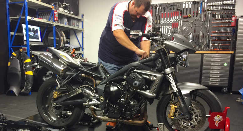 Precision engineer Ozzy Graf working on a motorbike during a service at Oz-racing Mechanical and Engineering